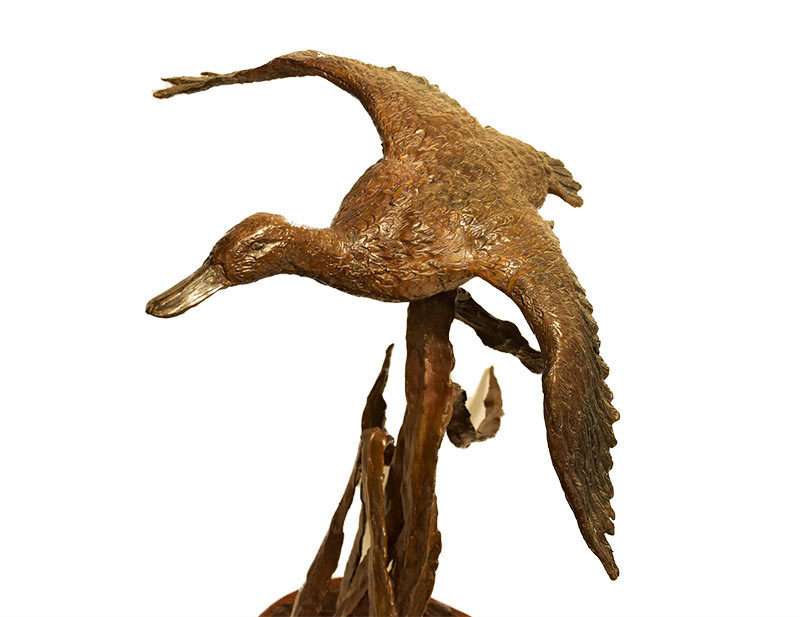 Dale M. Burr - Marsh Duster - bronze duck sculpture of available at Sculpture Collector
