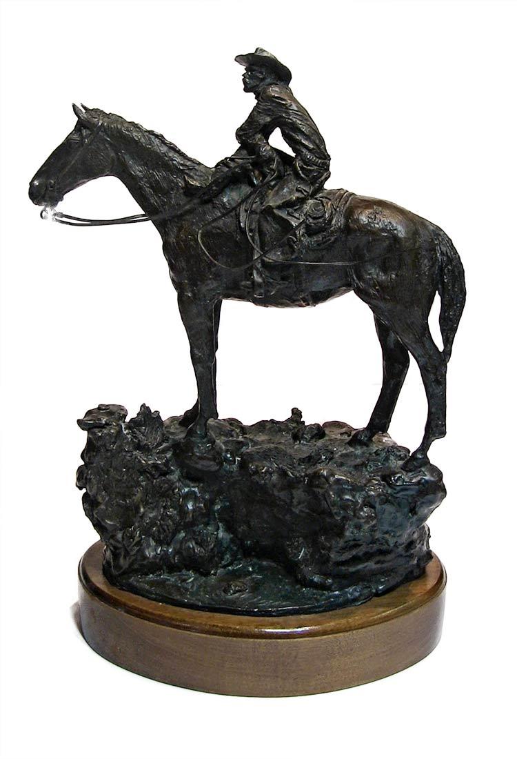 A western bronze sculpture horse and rider a sculpture by Jasper D'Ambrosi titled Holdin Herd