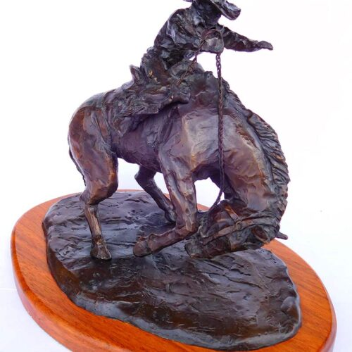 'Go On With It' Limited edition, a cowboy on bucking horse bronze sculpture by L. Soderburg available from Sculpture Collector