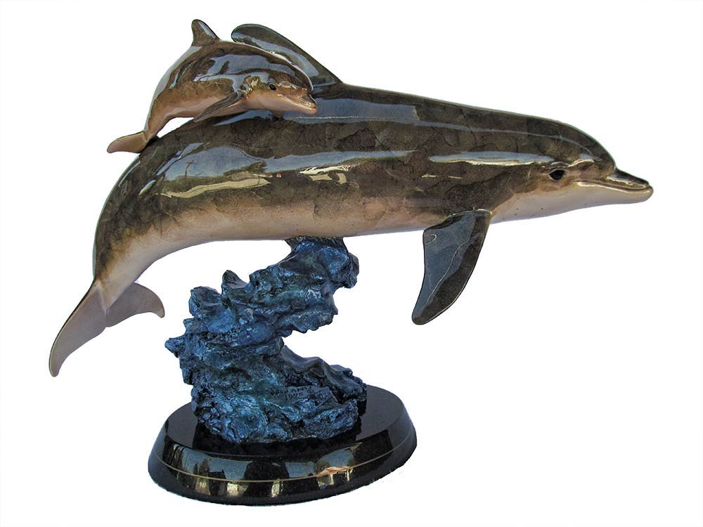 Sea Born a bronze dolphin sculpture by Wyland