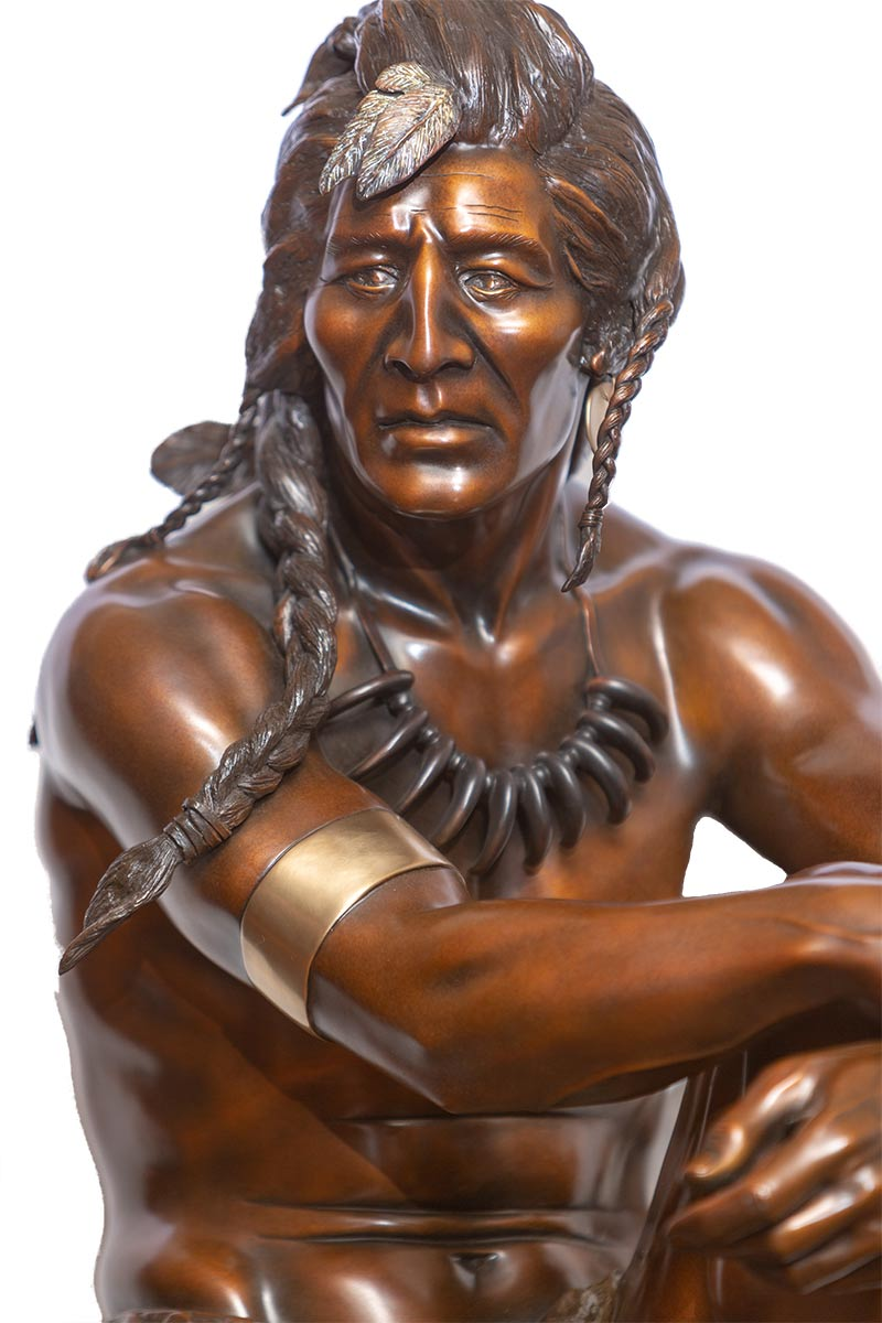 Solitude a bronze Native American warrior sculpture by Austin Barton