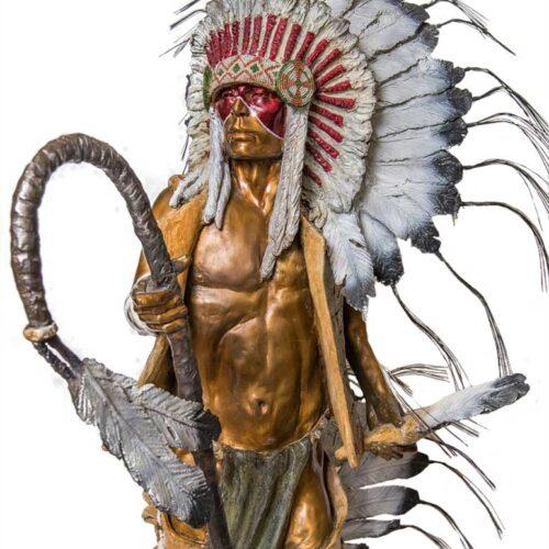 Brave Bear a Native American Warrior sculpture in bronze by Marie Barbera