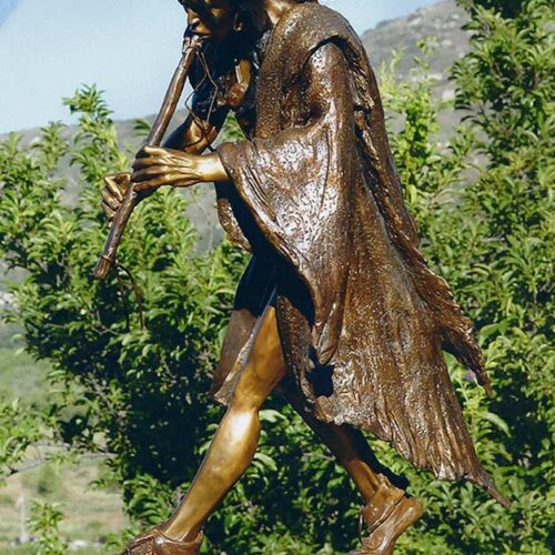 The Navajo Flautist a bronze sculpture of a flute player by Marie Barbera