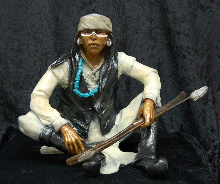 A Native American bronze sculpture titled White Mountain Apache by famous sculptor Marie Barbera