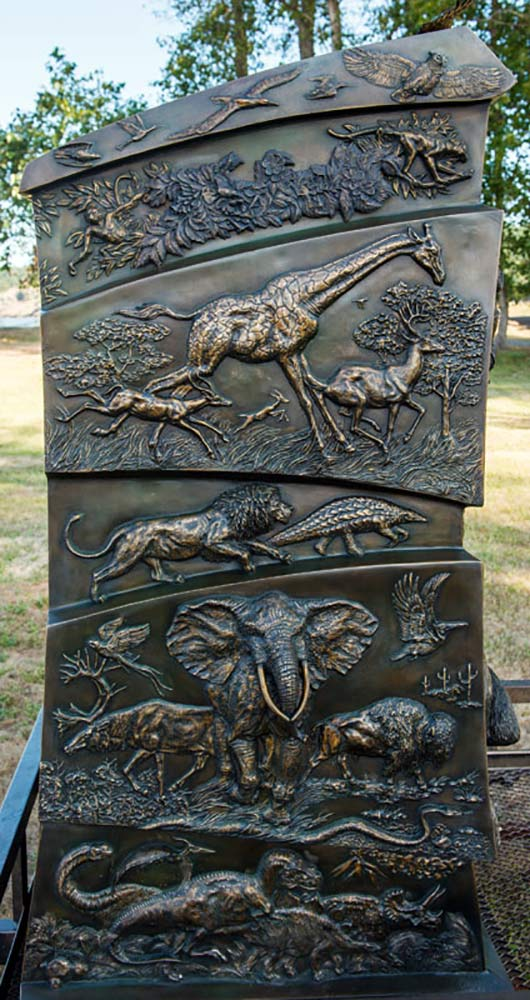 Discovering Our Wild World, large bronze animal-learning sculpture by John Bonnett Wexo