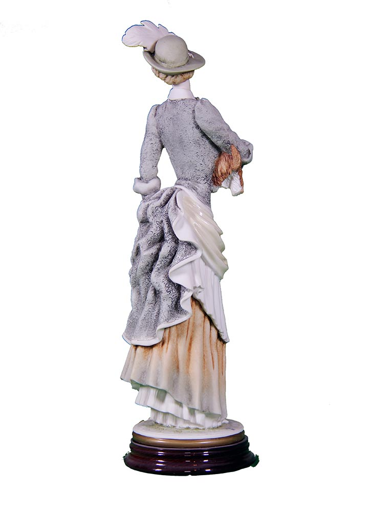 Sculpture in porcelain by Giuseppe Armani - Eloise holding her dog