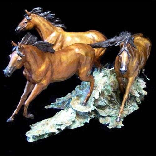 Freedom a bronze equine sculpture of Horse's stampeding by Marie Barbera