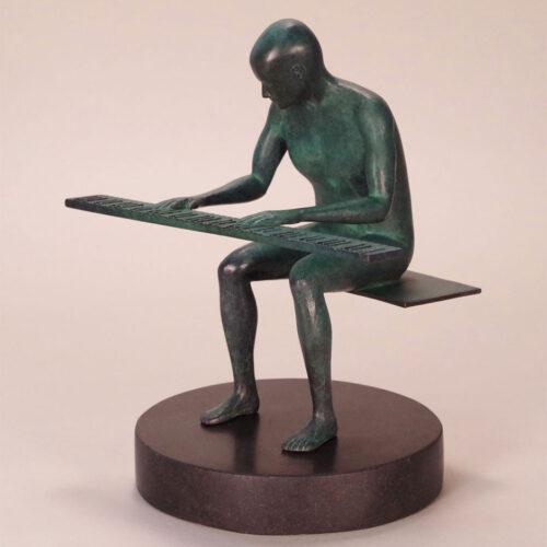 Pianoman a limited edition bronze sculpture by Robert E. Gigliotti