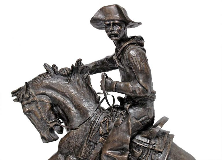 Remington The Cowboy a nicely done restrike of this famous bronze sculpture