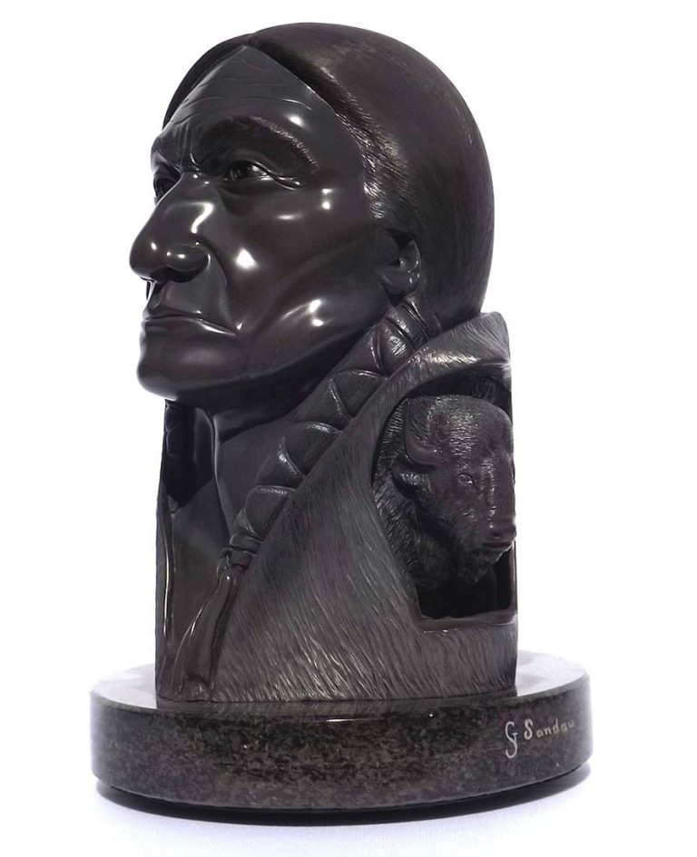 A Carved Stone Sculpture titled Buffalo Creation (Chief Sitting Bull) by Gerald Sandau