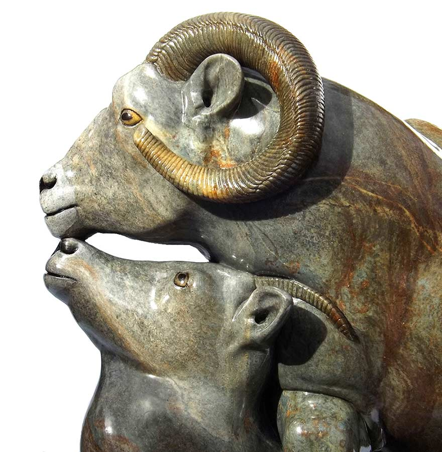 A Carved Stone Sculpture titled High Country Moment (Big Horn Sheep) by Gerald Sandau