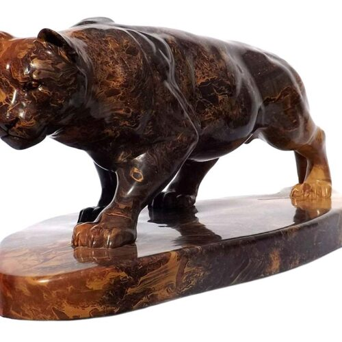 A Carved Stone Sculpture titled Stealth (Mountain Lion) by Gerald Sandau
