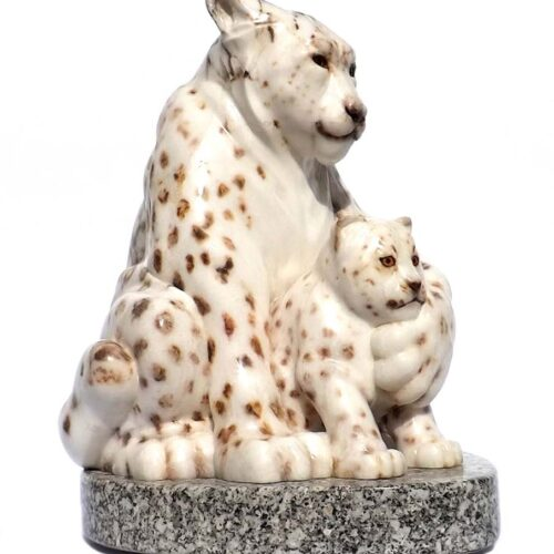 A Carved Stone Sculpture titled The Guardian (Snow Leopard & Kit) by Gerald Sandau