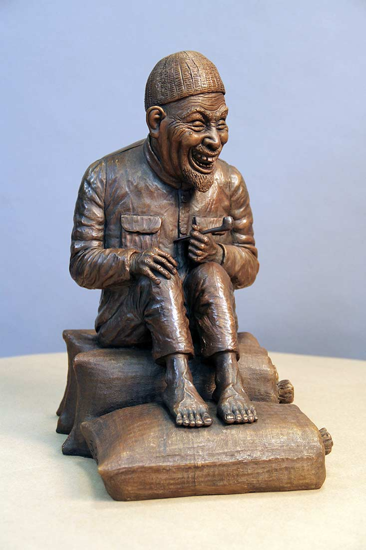 A Limited Edition Bronze Sculpture titled Old Asian Man Enjoying a Pipe by Chris Towle