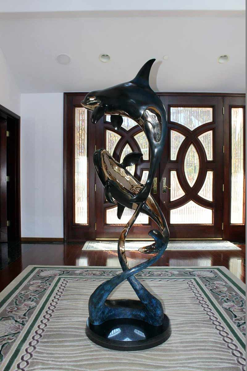 Two Orca's in a bronze sculpture titled Ocean Romance by Jason Napier