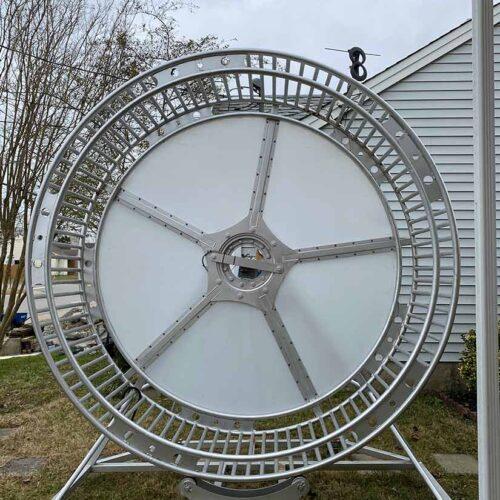 kinetic sculpture Rat Race human powered life-size rotating wheel