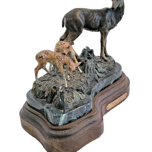 A limited-edition bronze sculpture of Doe (Deer) and her Fawns by noted sculptor David Manuel