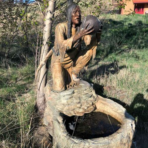 Cool from the Creek a life-size Native American bronze sculpture by noted sculptor Marie Barbera