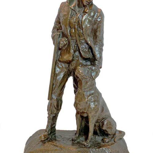 A Mark Hopkins sculpture of a hunter and his dog in bronze
